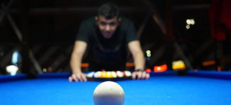 A pool ball on a pool table.