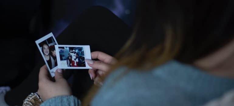 A girl looking at photos