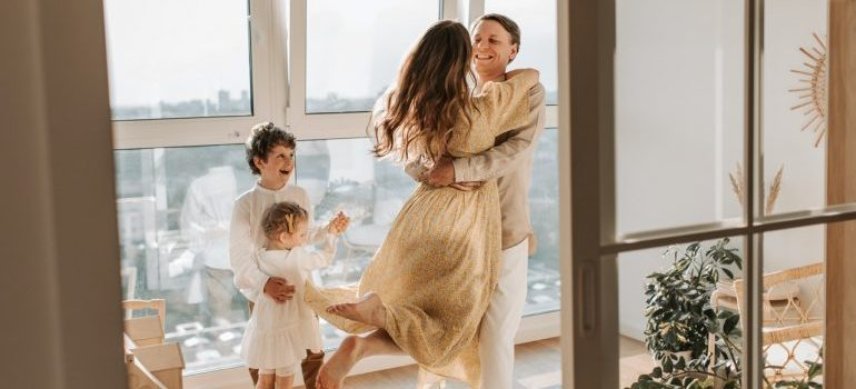A family of three in a room after a move