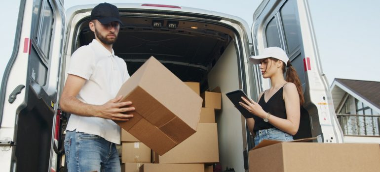 A mover and a client working with boxes
