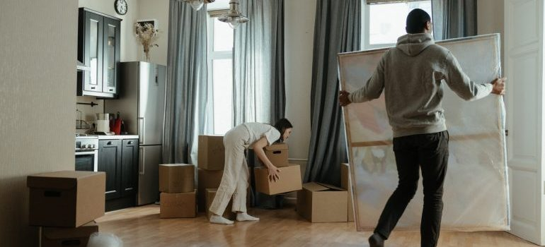 Two people unpacking a home