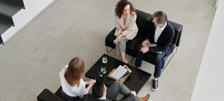 FOur people at a meeting talking