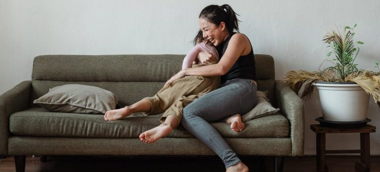 A woman hugging her child and laughing