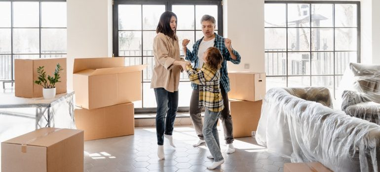 parents and kid preparing for a move