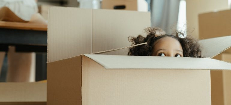 girl peeking from box
