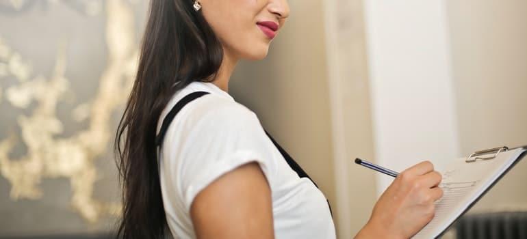 Woman make a checklist and organize the perfect spring move