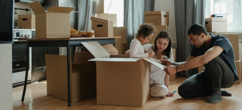 A family unpacking so that they can get to know Nashua faster