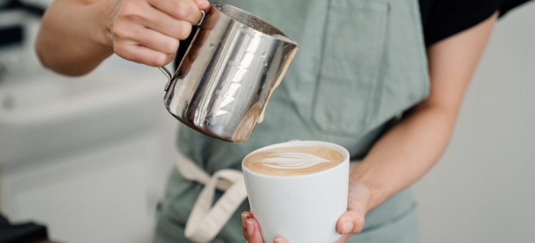 A person making a coffee