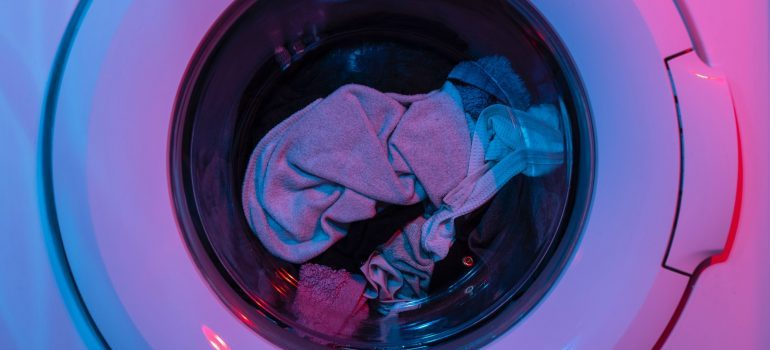 Washing machine with clothes inside.