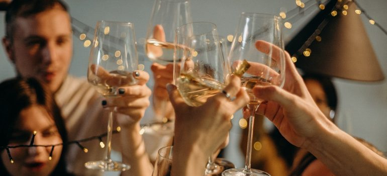 People holding champagne glasses in the air