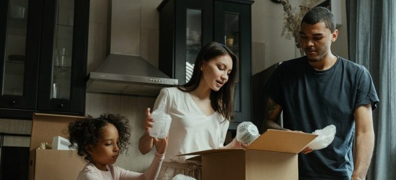A family unpacking in order to throw a housewarming party