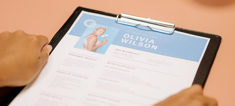 Person holding a paper with CV
