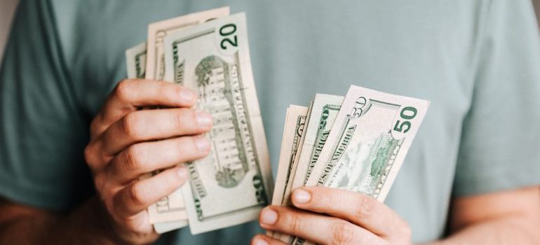 A person holding money in both hands