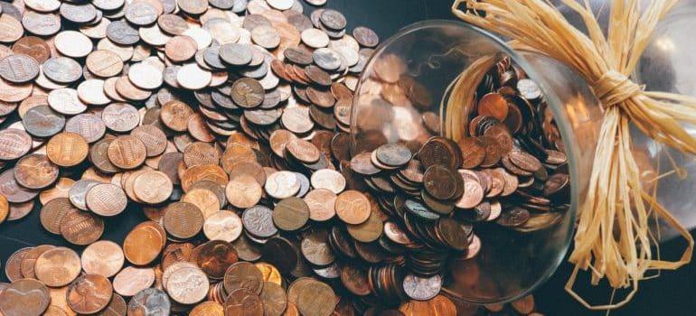 Spilled pennies from a money jar