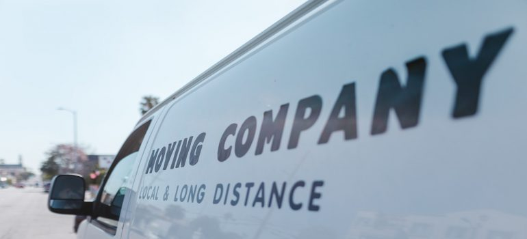 A truck of a moving company with the label on the side.