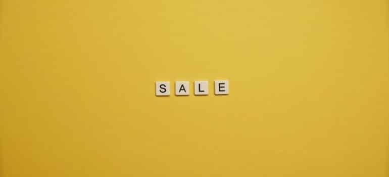 The word sale written in scrabble cubes