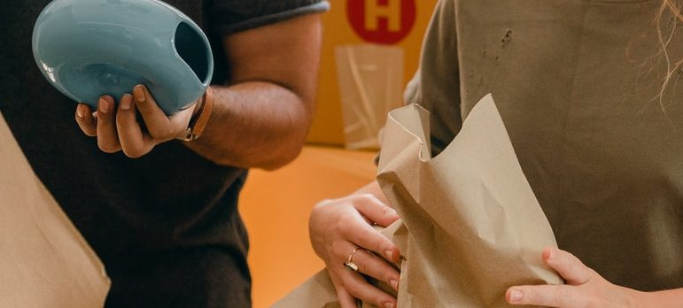two people holding items to pack