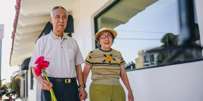 A man and a woman walking