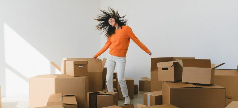 Woman with different boxes.