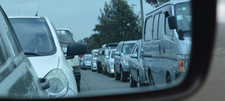 cars in lane in a rearview mirror