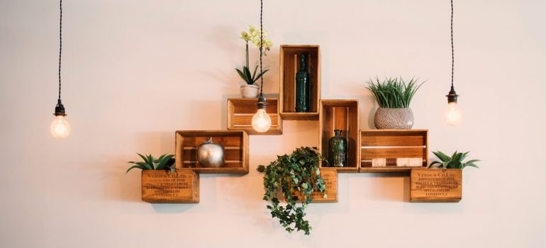wooden shelves on the wall with items on them