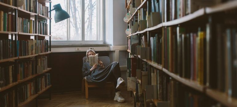 Girl sitting in a corner and reading.