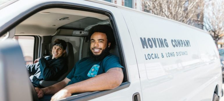 Movers in a moving truck.