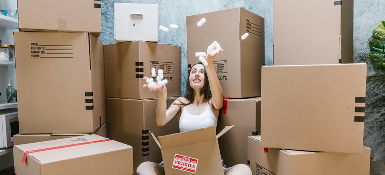 person surrounded with moving boxes