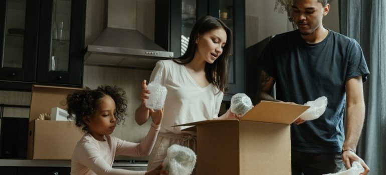 Family unpacking their kitchen after the move.