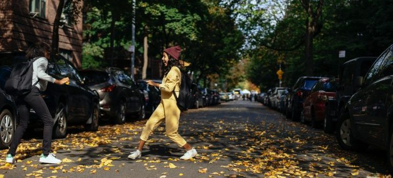 People walking on the street thinking of fall activities in Derry