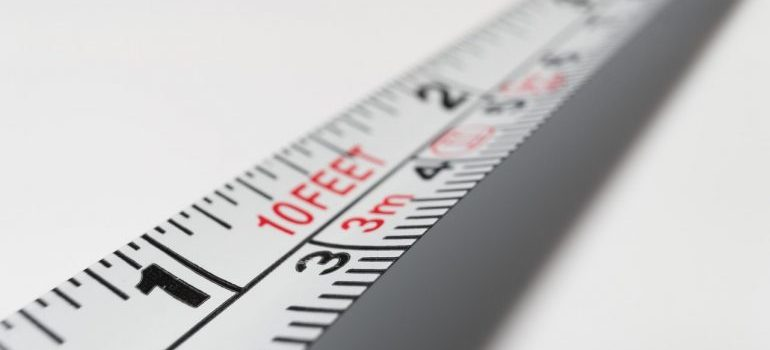 measuring tape used for taking measurements when moving a piano across states