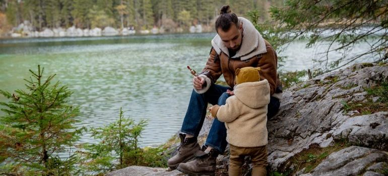 Father and kid playing in the nature.
