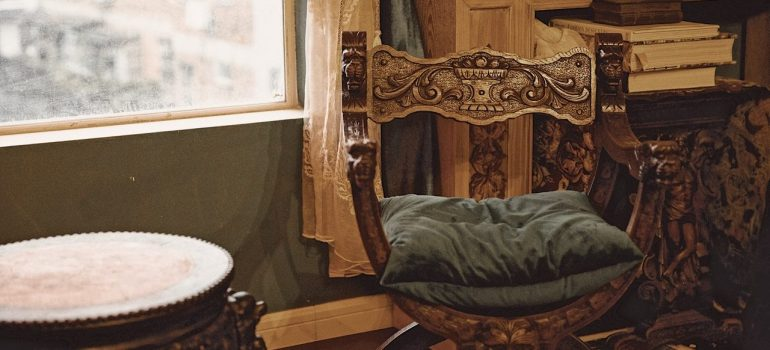 an antique chair in a room as the main subject of our tips for moving antique furniture